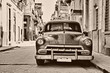 Sepia toned vintage classic american car parked in a street of O