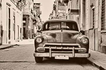 Fototapeta Miasta Sepia toned vintage classic american car parked in a street of O