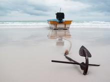 Boat Anchored On Beach
