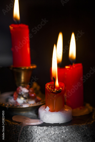 candles lit, colored dark / black / background - burning candle wax ...
