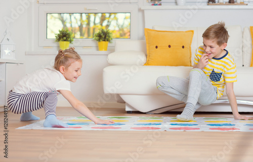 Fotografie, Obraz  Two happy children playing exciting game at home