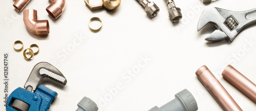 Fotografija Plumbers Tools and Plumbing Materials Banner with Copy Space