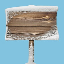 Wooden Sign With Snow Isolated...