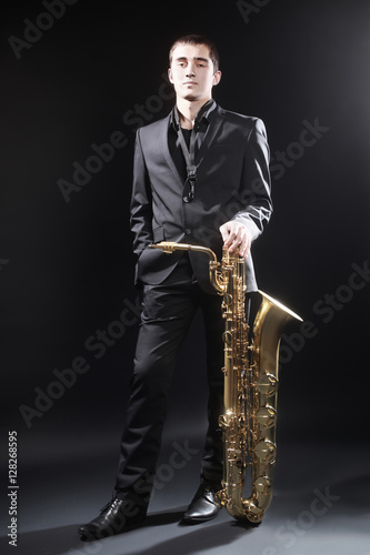 Saxophone Player Saxophonist jazz man with Sax baritone Canvas Print