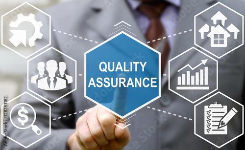Businessman presses quality assurance word icon Canvas Print