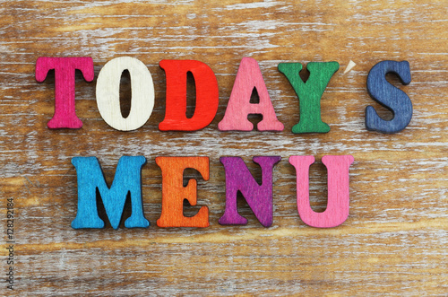 Fototapeta Today's menu written with colorful letters on rustic wooden surface