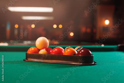 Canvas Print Billiard balls in a pool table.