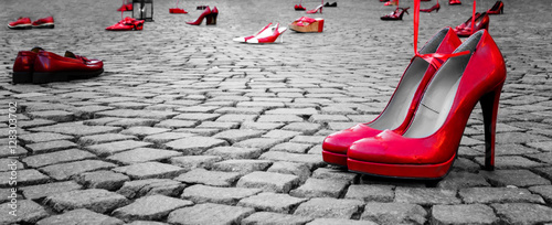 Obraz red shoes to stop violence against women on a city square - fototapety do salonu