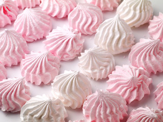 white and pink meringue cookies, shallow depth of field, selective focus