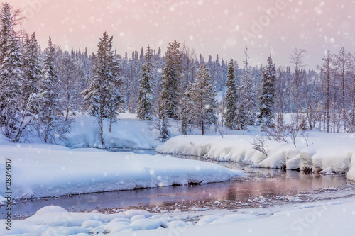 Winter snowy sundown landscape with forest and river Fototapet