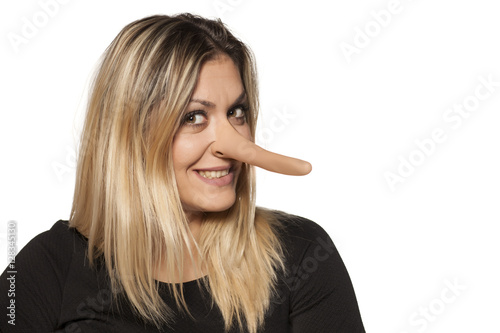 Fotografia, Obraz  smiling young woman with elongated nose. concept of lying