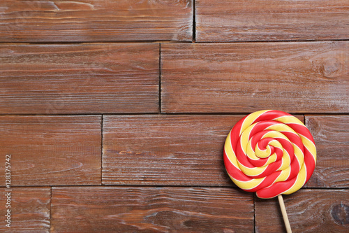 Sweet lollipop on a brown wooden table - Buy this stock photo and