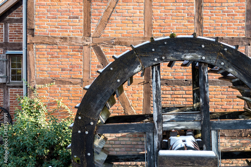 wooden wheel of an historic water mill