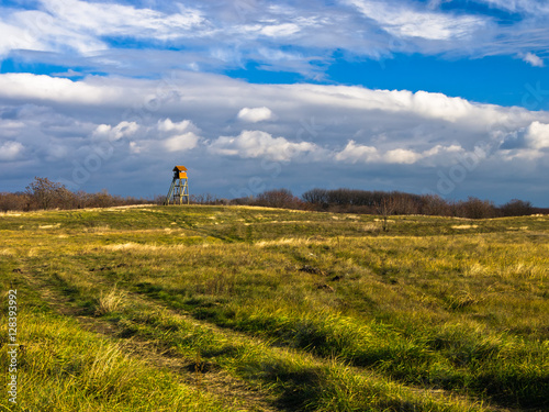 Foto op Aluminium Blauw Hunting watchtower on a meadow at sunny autumn day, Deliblatska pescara, Serbia