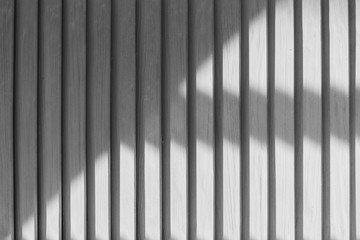 White wooden shutters interesting unusual abstract closeup texture with shadow