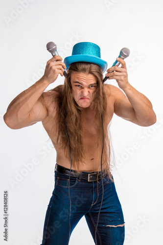 singer bodybuilder shirtless with long hair in a blue hat with a microphone on a Wallpaper Mural