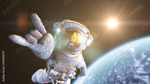 Fotografie, Obraz Rock`n Space, Astronaut in orbit. 3d render