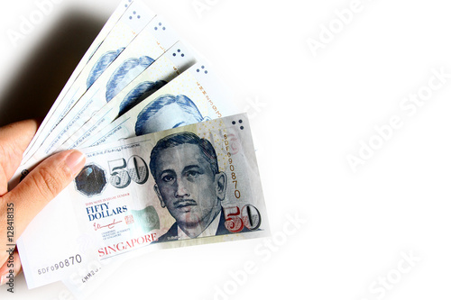 Singapore Dollar in white background / The Singapore dollar