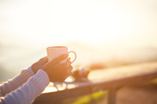 Woman Drinking Coffee In Sun S...
