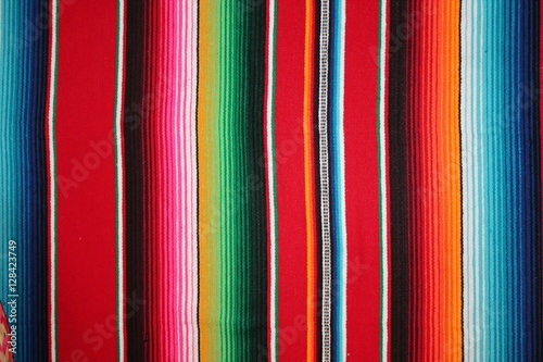 Obraz Poncho Mexican background Mexico cinco de mayo rug  serape fiesta with stripes blanket pattern copy space stock photo, stock photograph, image, picture,  - fototapety do salonu