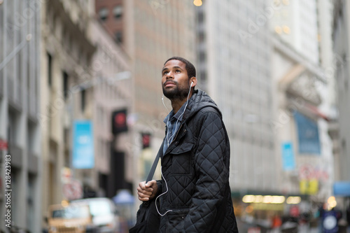 Fotografie, Obraz  Attractive young African American man in the city, looking up