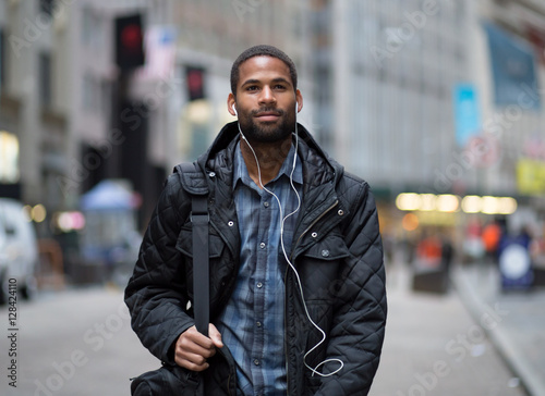Attractive young African American man commuting to work Plakát