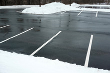 Empty Parking Lot With Snow Re...