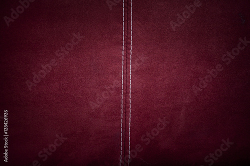 Photo Red alcantara leather background texture with stitching