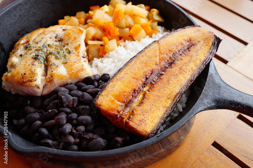 Traditional Costa Rican Casado meal with rice, beans, plantains and fish Canvas Print