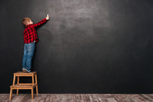 Child Standing On Stool Over C...