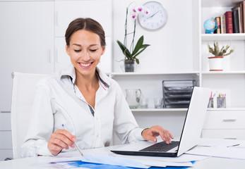 woman writing down information