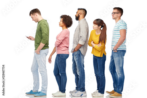 Fotografie, Obraz group of people in queue with smartphone