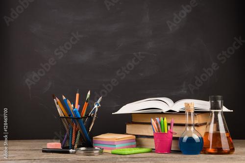 Fotografía  Education concept - books on the desk in the auditorium