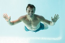 Smiling Shirtless Man Swimming...