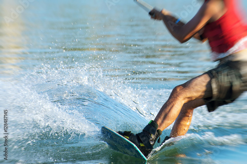 Papiers peints Nautique motorise Man on wakeskate doing tricks. Cable Wakeboard.