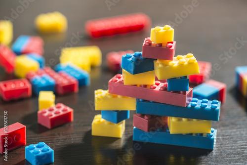 Plastic blocks on table. Wallpaper Mural