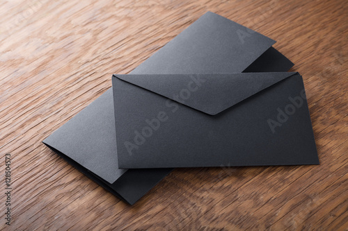 Fototapeta black envelope on  wooden table obraz