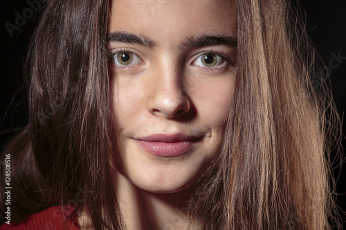 Fotografie, Obraz  portrait of a beautiful, smiling woman, isolated on black