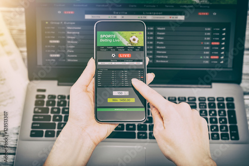 Vászonkép betting bet sport phone gamble laptop concept