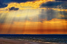 Cloudscape With Crepuscular Rays Or Sunbeams Over The Baltic Sea. Stegna, Pomerania, Northern Poland.