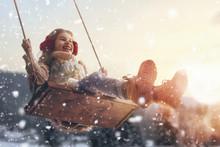 Girl On Swing In Sunset Winter