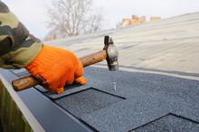 Builder Building Roof. Worker ...
