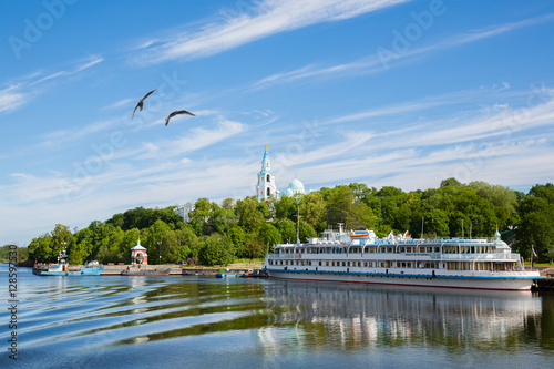 Passenger tourist ship standing at the pier on island of Valaam. Fototapet