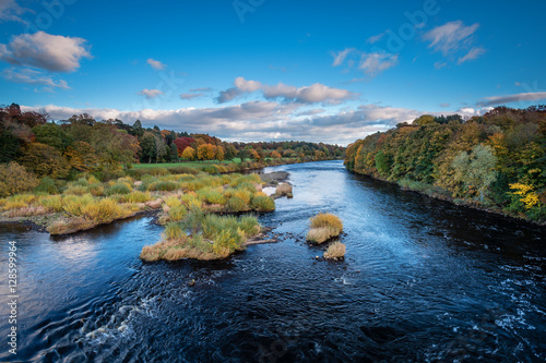 River Tyne below Corbridge, winding its way down the Tyne Valley, in Northumberland, on a sunny day