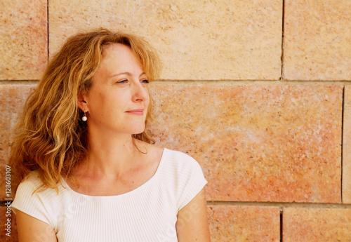 Fototapeta  Portrait of beautiful 40 years old woman outdoors