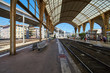 France, Nice, 15 august 2016: Panorama of the railway station in the center, sunny day, blue sky, a lot of tourists, Rails under glass a roof, in front of shaped visor, sncf, gare