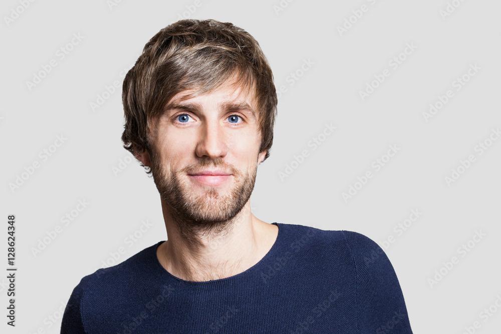 Fototapeta Cheerful smiling young man studio portrait