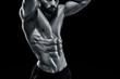 Muscular bodybuilder guy doing posing