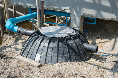 Valokuva  Waste treatment tank or septic tank installation  in construction site