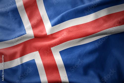 waving colorful flag of iceland. Obraz na płótnie
